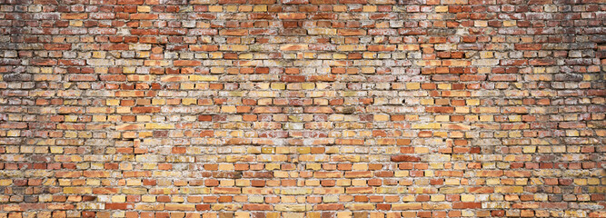 Panoramic background of old vintage red brick wall