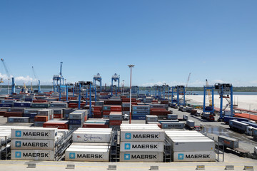 Shipping containers and cranes are seen in the port of Mombasa