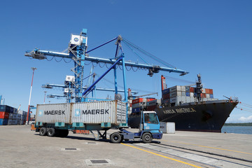 Containers are seen being transported on a container ship as it is docked in the port of Mombasa