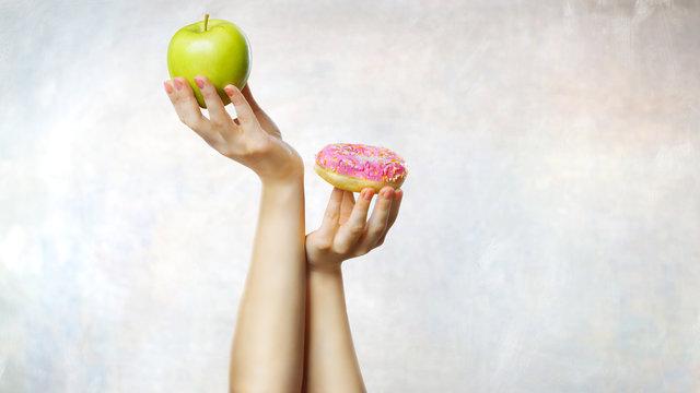 Choosing between green apple and doughnut