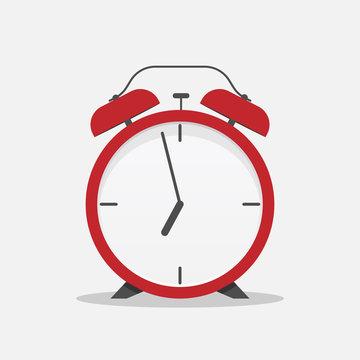 Classic alarm clock over white background