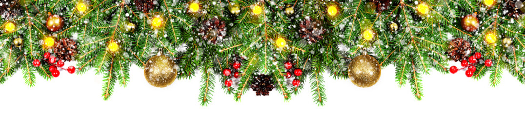 Amazing christmas border with fresh fir branches isolated on white. Golden balls, snow, cones, little light and red berries composition.
