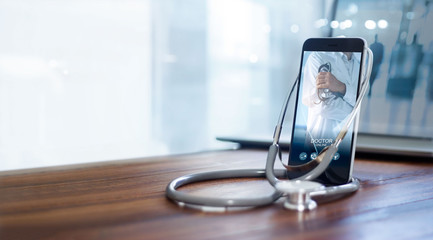 Fototapeta Doctor online, online medical communication network  with patient, Online medical consultation, Doctor through the phone screen using stethoscope checks and analysis health care.
