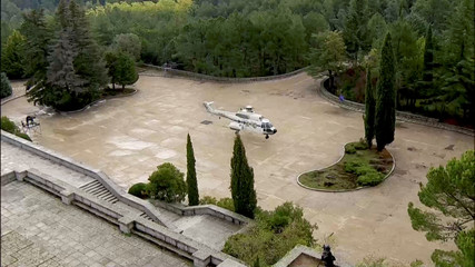A still image taken from a video shows a helicopter at The Valle de los Caidos (The Valley of the Fallen), the state mausoleum where late Spanish dictator Francisco Franco is buried, in San Lorenzo de El Escorial