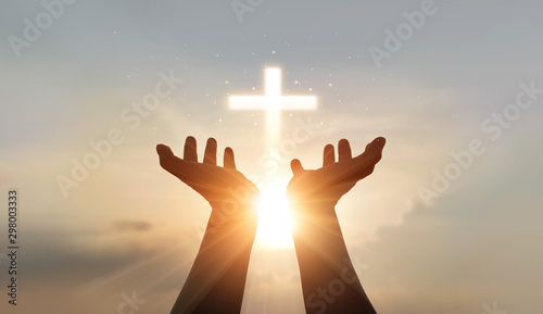 Leinwandbilder Man hands palm up praying and worship of cross, eucharist therapy bless god helping, hope and faith, christian religion concept on sunset background.