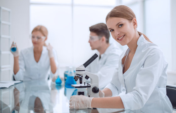 close up. woman scientist sitting at the lab table