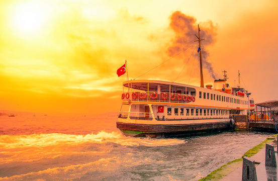 Muslim architecture and water transport in Turkey - Beautiful View touristic landmarks from sea voyage on Bosphorus. Cityscape of Istanbul at sunset - old mosque and turkish steamboats, view on Golde