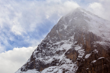 North wall of Eiger mountain with ice and clouds / Eiger Bordwand mit Eis und Wolken
