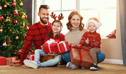happy family   open presents on Christmas morning