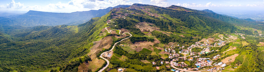 Top view Aerial photo from flying drone over Mountains and winding mountain paths exciting steep at...