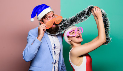 Manager tinsel celebrate new year. Corporate holiday party ideas. Christmas party office. Winter corporate party. Office christmas party. Happy man and woman wear santa hats and funny sunglasses