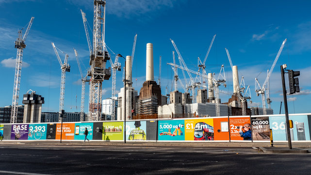 Battersea Power Station, London. Hoarding illustrating the benefits of gentrification following local residential and business redevelopment.