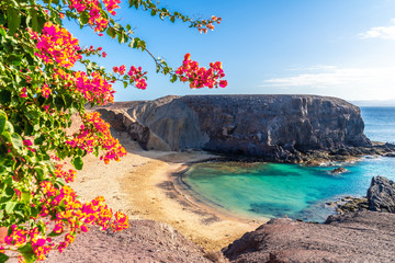 Landscape with turquoise ocean water on Papagayo beach, Lanzarote, Canary Islands, Spain