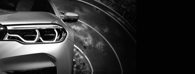 Wall Mural - Close up detail on one of the LED headlights modern car.copy space