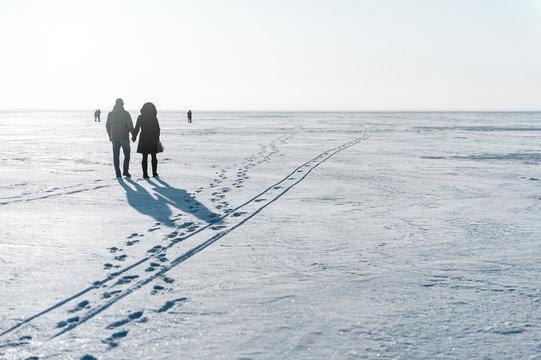 Winter walking on the frozen lake.