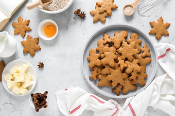 Keuken foto achterwand Bakkerij Christmas baking culinary background. Xmas gingerbread on kitchen table and ingredients for cooking festive cookies. New Year holiday decorations