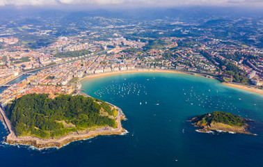 High view of San-Sebastian with Beach of La Concha and boats at sea