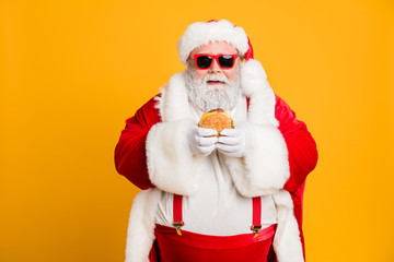 Portrait of funny funky fat santa claus dont care about health eat fast food big sandwich on x-mas...