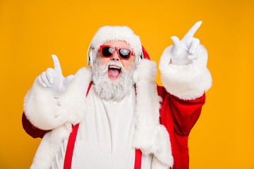Close up photo of funky funny fat crazy santa claus celebrate x-mas party wear headset sing listen music raise fingers have red hat headwear trendy suspenders isolated shine color background