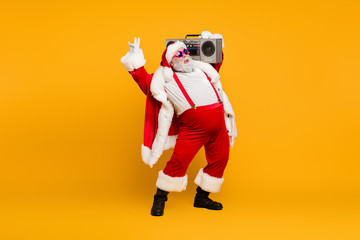 Full length photo of funny fat santa claus hipster with big belly hold boombox have fun listen...