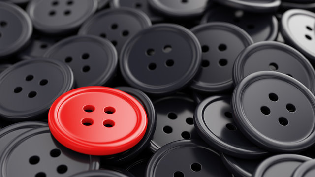 Unique red sewing button among black ones