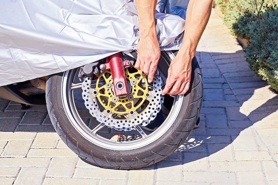 Closeup view of motorcycle wheel with waterproof cover for motorcycle