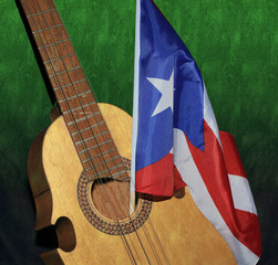 Image of an antique Puerto Rican cuatro with a Puerto Rican flag. A Puerto Rico strings musical  folk instrument.
