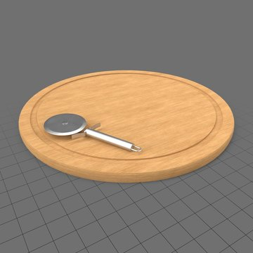 Pizza cutter on cutting board