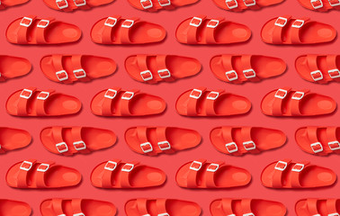 Wall Mural - Seamless Pattern of Fashionable beach coral birkenstock on bright coral background. Flat lay top view copy space. Creative beach concept, stylish summer shoes, vacation, travel. Trend coral color