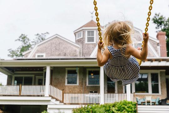 Child on Backyard Swing