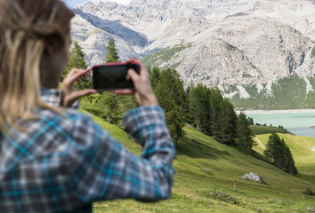 Woman taking a pic into the wild