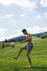 Man playing soccer outdoors