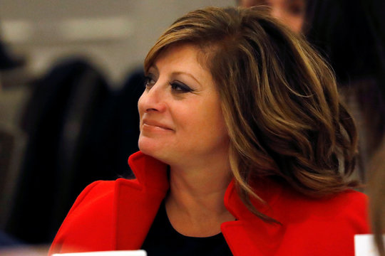 Fox Business television personality Maria Bartiromo listens to Robert Iger, Chairman and CEO at The Walt Disney Company at Economic Club of New York