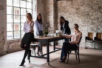 Women team portrait in office
