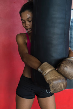 strong black woman resting after boxing workout