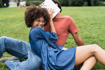 Happy young black couple in the park