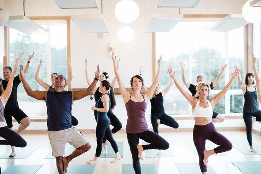 Yoga instructor teaching a class