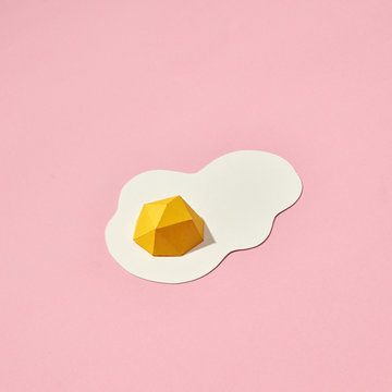 Hand crafted paper fried eggs on a coral background with space for text. Breakfast concept. Pantone 16-1546 Living Coral is the color of the year 2019. Top view