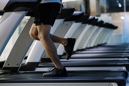 Man running on treadmill in health club