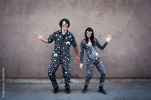 Couple Wearing Googly Eye Suits
