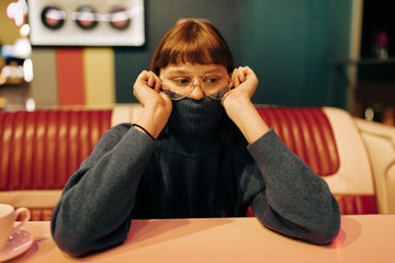 young woman sitting in a fast food