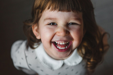Laughing Toddler Girl Looking at Camera