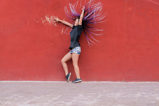 Woman with box braids throwing her long hair