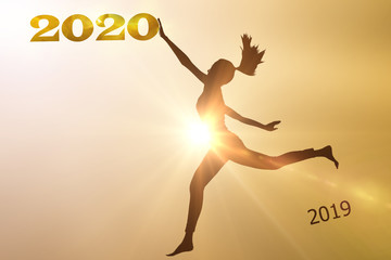 Silhouette female jumping from 2019 to 2020.