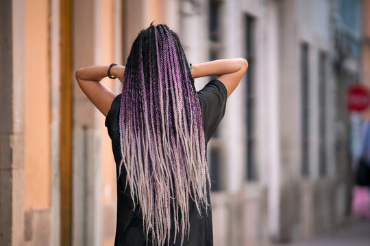 Young woman with purple box braids