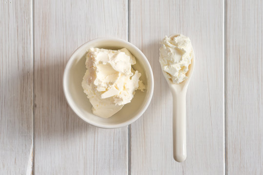 Fresh soft mascarpone cheese in a white bowl