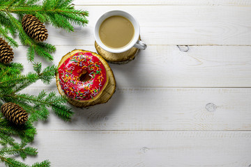 Christmas or New Year background with fir tree, coffee, donut on white board
