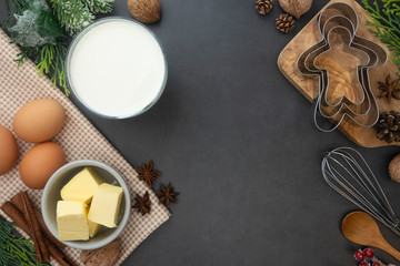 Chritmas baking food ingredients. Milk, butter, cinnamon, kitchen utensils. Flat lay cooking pastry mockup, gray background with copy space.