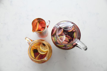 Overhead view of sangria cocktail in glass jugs