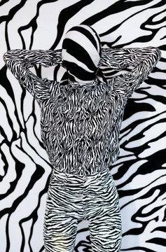 Anonymous model in headscarf near zebra wall